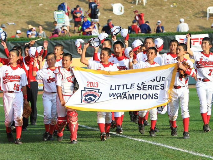 Japan players celebrate after defeating California in the Little League World Series championship game at Lamade Stadium.
