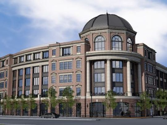 Hammes Co.'s proposed downtown office building's design sparked a philosophical debate at a Plan Commission meeting.