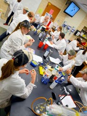 A group of the select 16 students in the ISU AgDiscovery program this summer work in the lab. Valder's Kat Drews was among the students selected.
