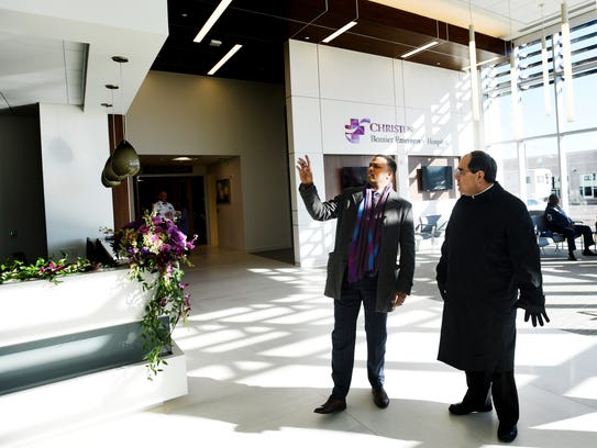 Bishop Michael Duca, right, gets a tour with Isaac
