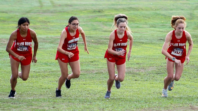 Glen Rose High School cross country runners (from left) Delaila Gomez, Zitlalli Mascorro, Mignon Miller and Jocelyn Mims fire off the line at the start of the Glen Rose Invitational  Wednesday at Squaw Valley Golf Course.