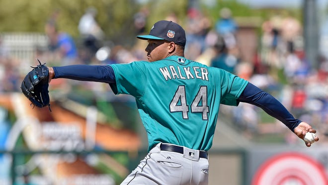 Seattle Mariners starting pitcher Taijuan Walker throws in the second inning of a spring training baseball game against the Kansas City Royals, Saturday, March 19, 2016, in Surprise, Ariz.