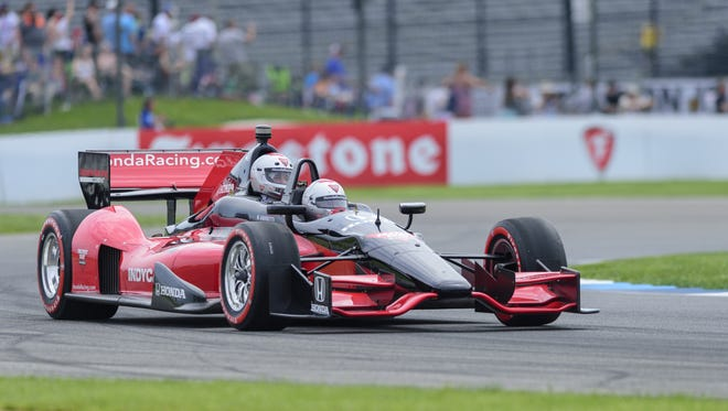 Mario Andretti drives a two-seater IndyCar around the road course ahead of the field of 24 drivers in this year's race before the running of the 2018 IndyCar Grand Prix, Saturday, May 12, 2018
