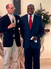 Rev. Jon Robbins, left, with Wintley Phipps at St. Paul's Church.