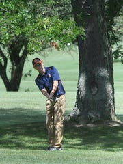 Galion's Mitch Dyer hits a chip shot during Friday's Tyger Invitational at Twin Lakes.