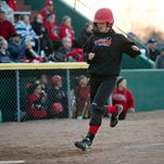 Port Huron's Madelyn Trombley scores a run during a softball game this season at Port Huron High School.