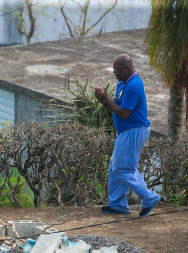 Dr. Rey Agard with the Delaware Medical Relief Team arrives in the village of Paix Bouche and heads to a house call.