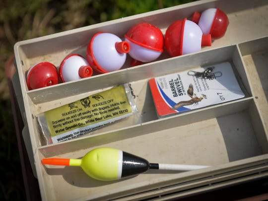 Bobbers, swivels and sinkers sit at the ready in Isaiah Athey's family tackle box Sunday, June 12, during the free fishing contest in Waite Park.