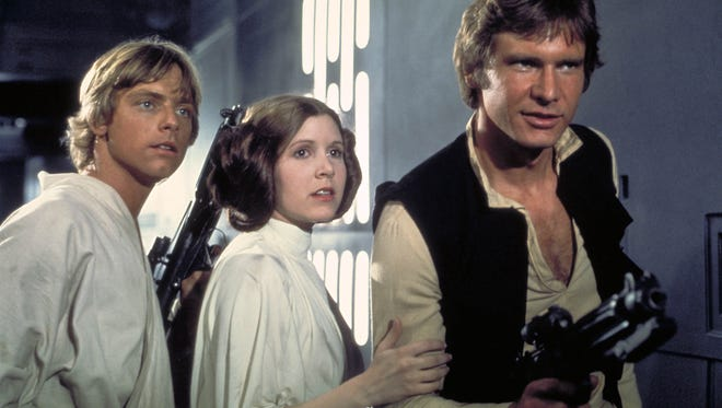 """Mark Hamill (from left), Carrie Fisher and Harrison Ford starred in the original """"Star Wars"""" trilogy from 1977-83. All three are reprising their roles in the upcoming """"Star Wars: The Force Awakens."""""""