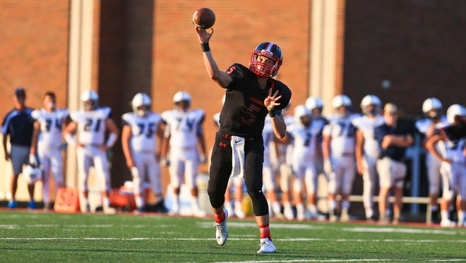 New Albany's Dylan Clark throws a pass while playing against Providence Aug. 18.