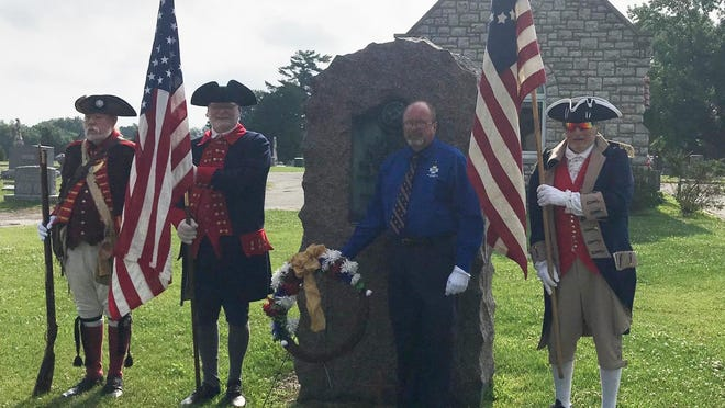 The Independence Patriots chapter of the Sons of the American Revolution on Saturday placed a wreath at the World War I Memorial at Woodland Cemetery in Independence, in honor of those who served and serve in the military forces of the United States. Those taking part were, from left, Stephen Sullins, Michael Hahn, Ron Paris and Alvin Paris, who trace their lineage back to an ancestor who fought in the Revolutionary War.