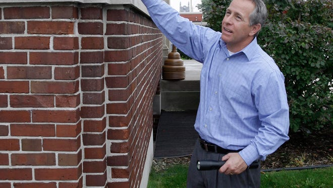 Director of Public Works David Biebel points out an architectural detail on the exterior of City Hall Oct. 2, 2014 in Sheboygan.