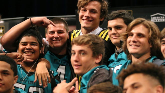 George Takacs is joined by teammates for a group photo following his U.S. Army All-American Bowl jersey ceremony in October. Takacs will sign a letter of intent to play at Notre Dame on Wednesday, the first day of the NCAA's new early signing period.