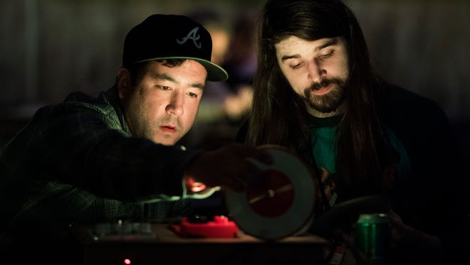 From left Justin Kennedy and Chris Hammond, both of Atlanta, practice on their turntable before DJ Kid Koala's Satellite Turntable Orchestra, which included audience participation, as part of the Big Ears festival, at The Square Room in Knoxville Friday, March 23, 2018.