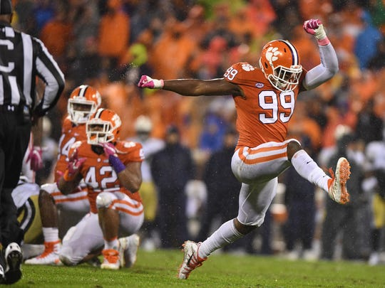 Clemson defensive lineman Clelin Ferrell (99) reacts after a defensive stop against Georgia Tech during the 1st quarter on Saturday, Nov. 28, 2017 at Clemson's Memorial Stadium.