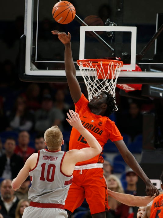 Florida's Gorjok Gak (12) is called for goaltending on a shot by Stanford's Michael Humphrey (10) in the first half of an NCAA college basketball game during the Phil Knight Invitational tournament in Portland, Ore., Thursday, Nov. 23, 2017. (AP Photo/Timothy J. Gonzalez)