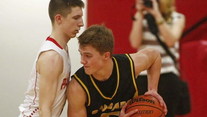 Cascade's Cameron Molan, right, was named the Statesman Journal's Athlete of the Week.