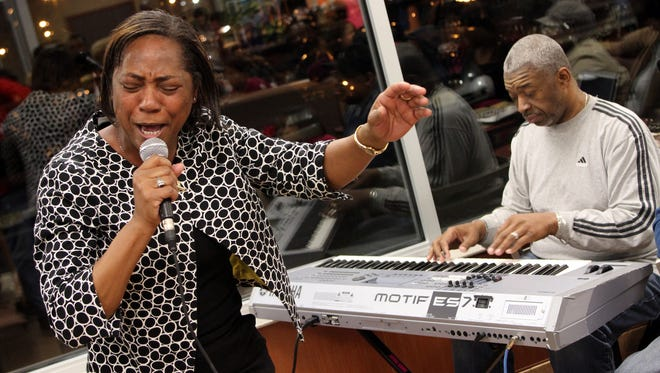 Pamela Luke of Asbury Park sings during her Gospelfest audition at the McDonald?s on Route 66 in Neptune on Friday evening. On the keyboard is Terence Kitchings of Paterson.