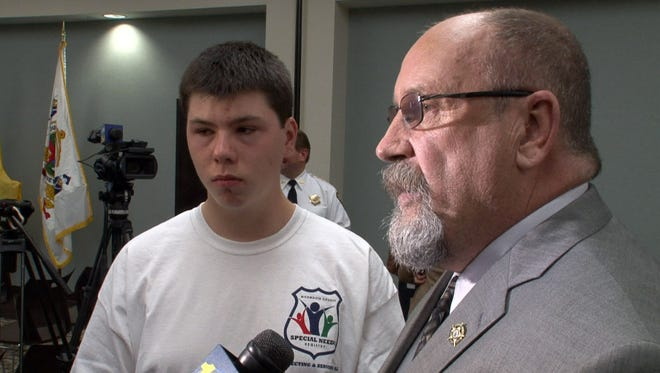 Autism awareness trainer Fran Hines is shown with his son Colton, 18, after a press conference in Freehold Wednesday, April 20, 2016, where Monmouth County Acting Prosecutor Christopher J. Gramiccioni and Sheriff Shaun Golden announced the county's program to establish a registry of people with special needs that will be a tool for first responders.