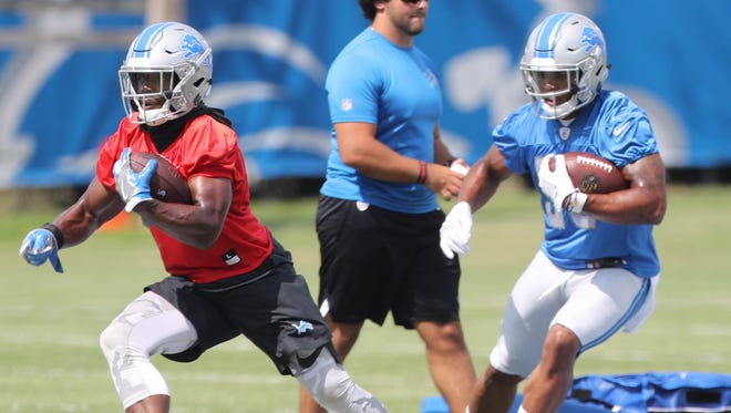 Detroit Lions running back Theo Riddick  and Tion Green go through drills during practice Sunday, July 30, 2017 at the practice facility in Allen Park, MI.  Kirthmon F. Dozier/Detroit Free Press