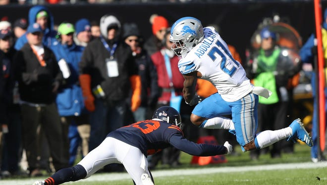 Ameer Abdullah goes over the Chicago Bears' Kyle Fuller in the first quarter of the Detroit Lions' 27-24 win Sunday, Nov. 19, 2017 at Soldier Field in Chicago.