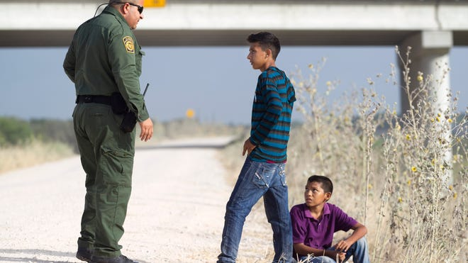 Two young unaccompanied Honduran boys turn themselves into a Border Patrol agent near the Anzalduas International Bridge not far from the Rio Grande  in Mission, Texas. They made it through the pipeline, into the U.S., and were taken into custody.