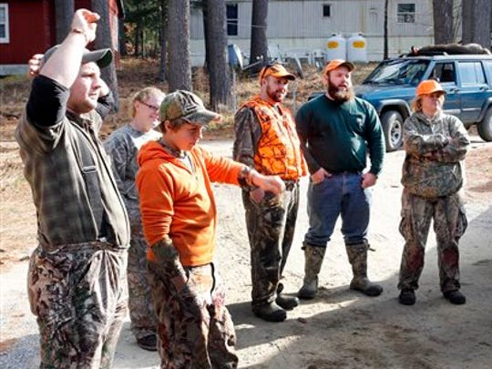 In this Nov. 12 photo, successful deer hunters gather at the deer check station in Hillsboro, N.H. Fish and Wildlife officials suspect that interest from local food connoisseurs is helping to level off a drop in the number of hunting license holders nationally, which has been on a steady decline over the last 30 years.
