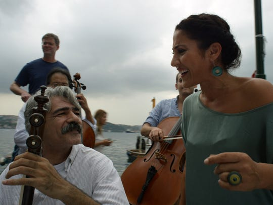 """Kayhan Kalhor (left) of Silk Road Ensemble and Aynur Doğan appear in """"The Music of Strangers."""""""