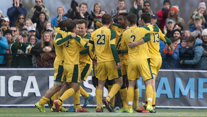 Vermont celebrates a goal during the America East men's soccer championship game between the Binghamton Bearcats and the Vermont Catamounts at Virtue Field on Sunday afternoon November 15, 2015 in Burlington.