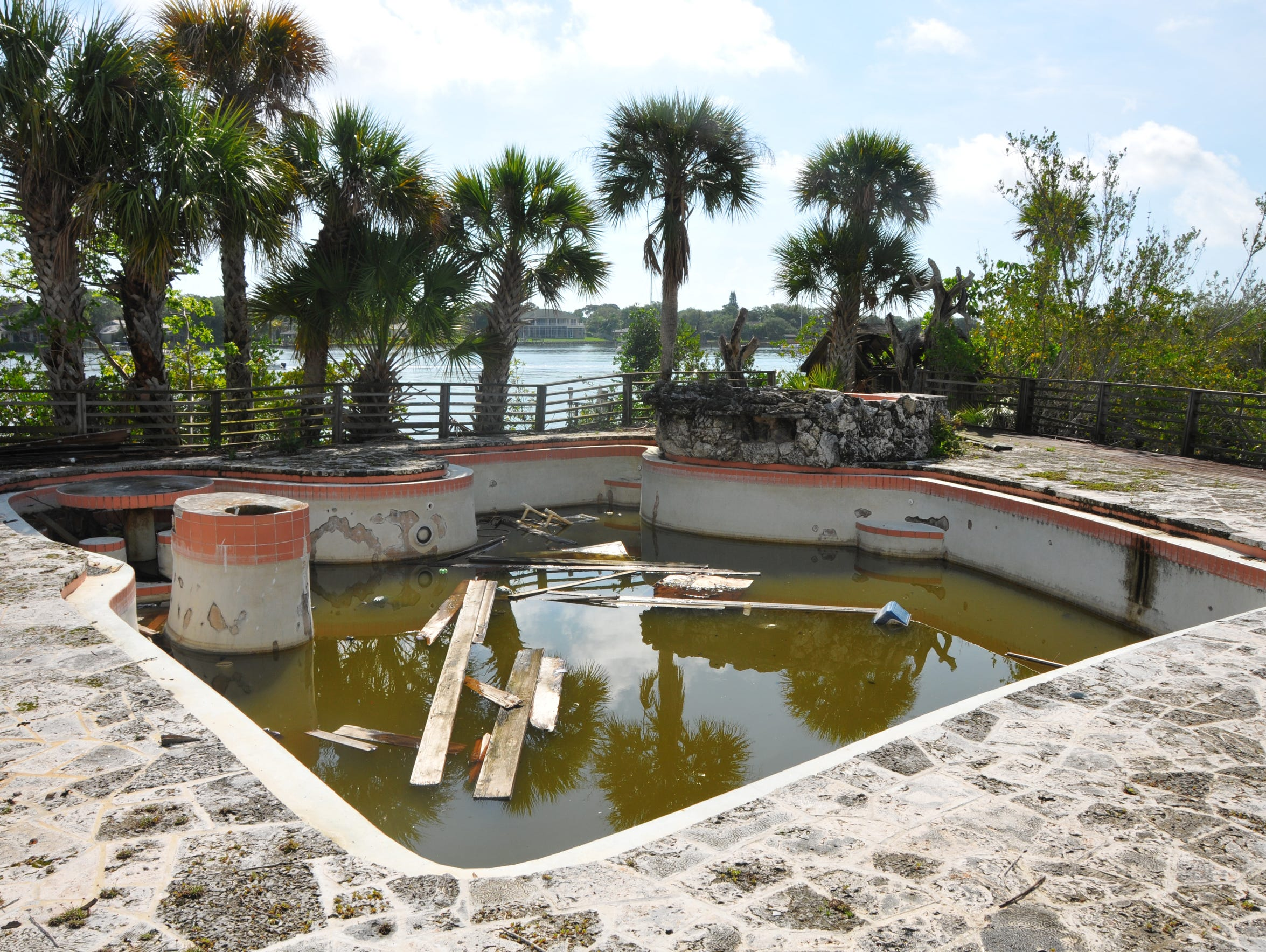 The old pool has a coral deck.