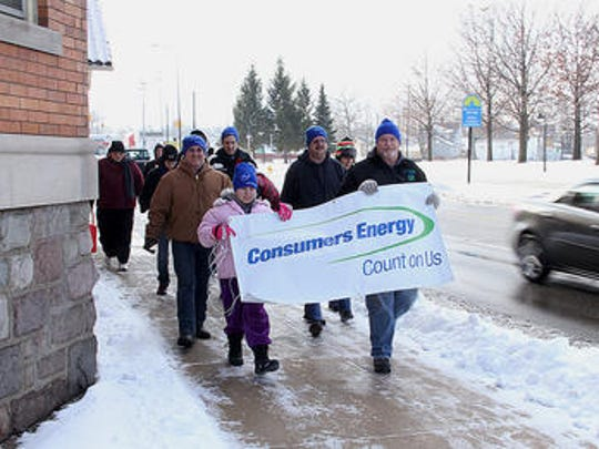 Consumers Energy team members make their way through downtown Battle Creek for the annual Walk for Warmth in 2013.