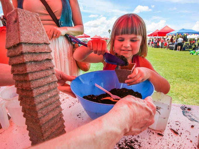 Lillian Grubbs, 5,  planted some seeds at one of the