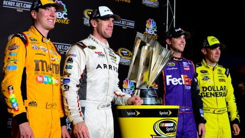 Kyle Busch, Carl Edwards,  Denny Hamlin and Matt Kensethpose with the NASCAR Sprint Cup trophy after the  Federated Auto Parts 400 at Richmond International Raceway on September 10, 2016 in Richmond, Virginia.