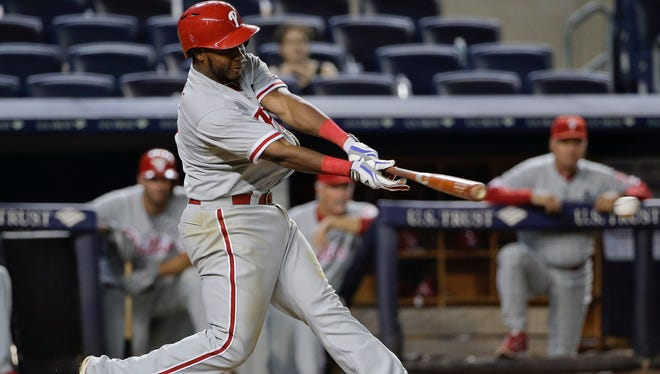 Maikel Franco doubles down the third base line to drive in two runs during the ninth inning Tuesday night.