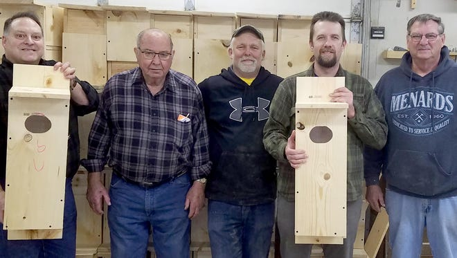 Maribel Sportsmen's Club and Francis Creek Sportsmen's Club members are still busy building wood duck and bluebird houses to enhance nesting capabilities for these species. Pictured, from left, Karl Puestow, Frank (Junior) Gosz, Joe Meyer, Mike Tesarik and Buck Habeck show some of the wood duck houses they built.