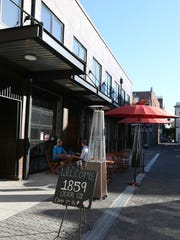 Outdoor seating in the alley at 1859 Cider Co. in downtown Salem.