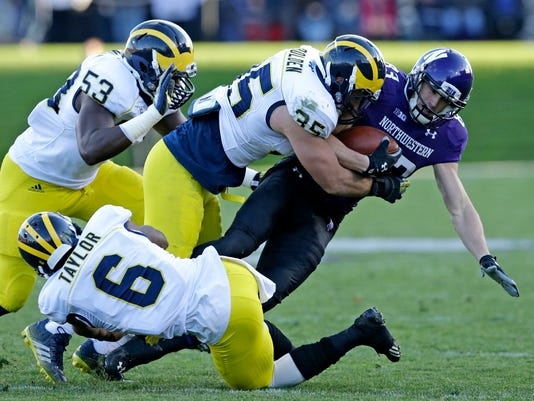 635520173517800283-AP-Michigan-Northwestern-Foo