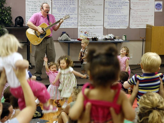 Leon County Library employee Gary Crew plays guitar,