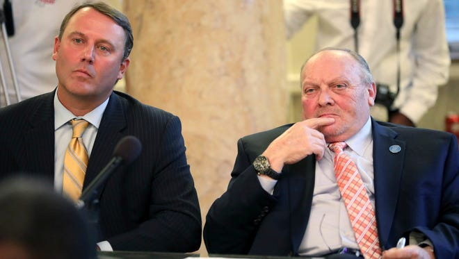 Rep. Jason White, R-West, chairman of House Rules Committee, left, and Republican Sen. Terry Burton, President Pro-Tempore and chairman of Senate Rules Committee, listen as speakers address possible changes to Mississippi's education funding formula during a public hearing at the Capitol in Jackson, Miss., Thursday, Nov. 17, 2016.