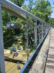 """Since the transformation of Byram's Swinging Bridge into a footbridge, couples have been placing """"love locks"""" on it. Mayor Richard White said the tradition is good for tourism and that engineers have assured him the bridge will hold """"thousands"""" of locks."""