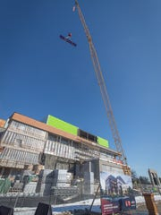 """The final beam was lifted to the top of the new Chemistry Biology Building at UW-Stevens Point Feb. 27. Faculty, staff, students, community members and legislators joined a """"topping out"""" ceremony marking the four-story building reaching its tallest point."""