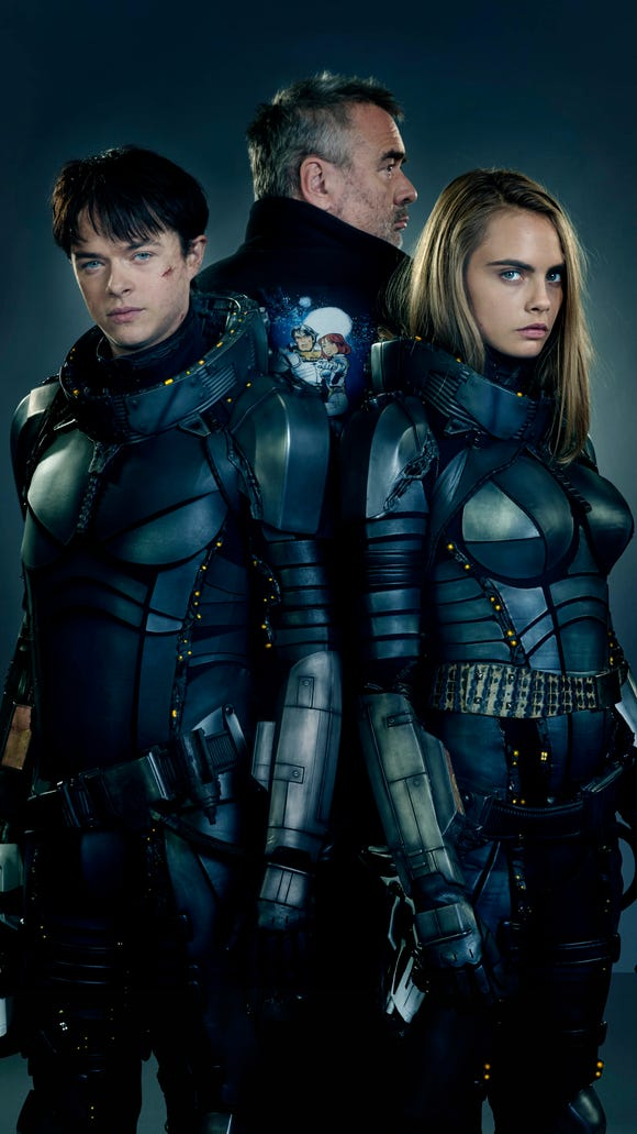 Dane DeHaan (left), director Luc Besson and Cara Delevingne