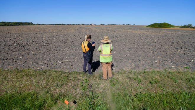 Independent contractors survey the Foxconn site on Highway KR east of I-94 in Mount Pleasant on Wednesday. Racine County officials on Wednesday confirmed the location of the massive Foxconn factory that someday could employ thousands.