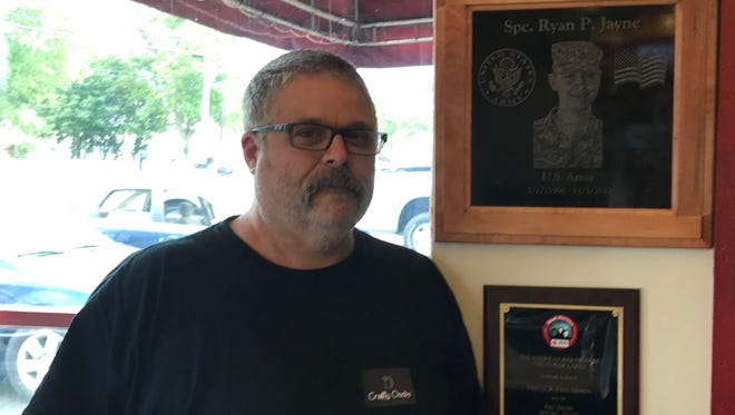 Kent Skeens, owner of Big Phatdaddy's BBQ on Lake Road in Horseheads, stands next to a tribute to his fallen son Ryan P. Jayne. Kent began the barbecue business in honor of his son's longtime dream to open one. Thursday, Sept. 14, 2017