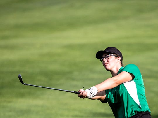 Newark Catholic's  Patricia Windholtz  hits the ball  at the LCL season opener at Harbor Hills Country Club Friday morning.