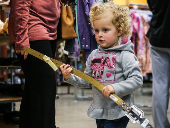 Avery Albert, 2, carries a new belt just in time for