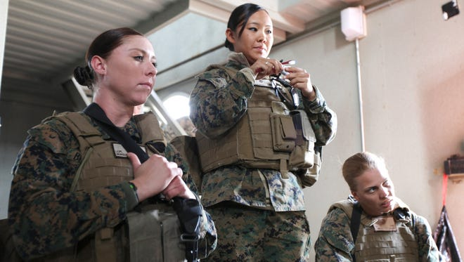 Lance Cpl. Michelle Bergley, Cpl. Susan Winkler and Cpl. Amanda Lowe, teach a hygiene class to Afghan role-players during final engagement training  Jan. 11 at Camp Pendleton,Calif., in preparation for an upcoming deployment with 1st Marine Expeditionary Force.