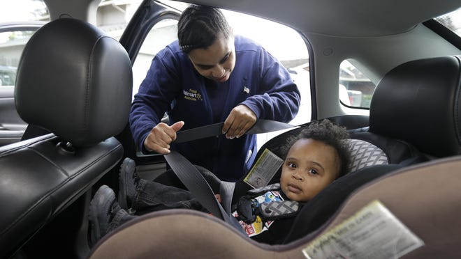 Shannon Henderson buckles her son, Justin, 1, into his car seat improperly. A clinic at Reid Health will demonstrate the correct way to do it.