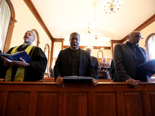 From left, the Rev. Dwayne Jackson, co-pastor of the Second Reform Church of Hackensack; George Maize IV, pastor of the Trinity Baptist Church of Hackensack; and Carl Phipps, the worship pastor at the Bethel Gospel Tabernacle Church in Jamaica, Queens, at the prayer service on Wednesday.