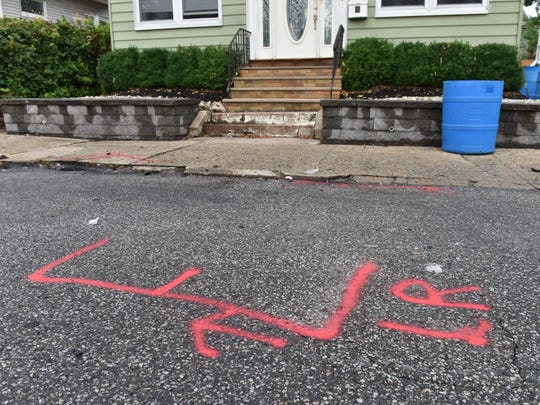 A food delivery man was shot on 34th Street in Paterson on Thursday in the early morning hours July 26, 2018. Red paint marks where the car he was driving came to a stop after crashing.